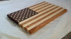 Inspired by Old Glory, this functional art is crafted from American Midwest grown cherry, maple, and walnut. The 50 inlaid curly maple stars