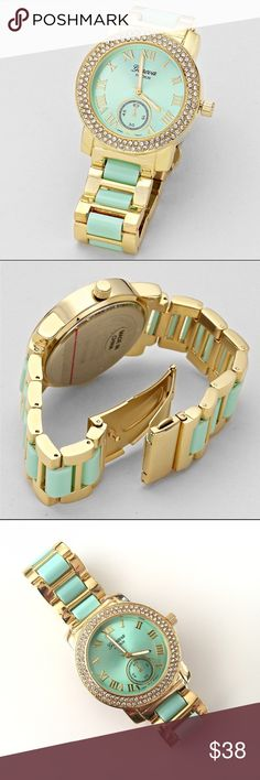 """Mint & Gold Crystal Watch These two tone watches are perfect for everyday wear. Stack with other bracelets for the perfect arm candy or wear alone.   *Case size approx 1.75""""  *Band approx 0.75"""" Wide  *Stainless steel back  *Fold over snap closure  *Battery included Accessories Watches"""