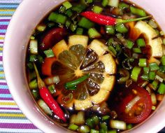 Finadene (soy sauce mixed with hot peppers, lemon, onions) - pour over bar-b-q ribs or chicken or whatever you like