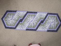 Recent table runner for my large wooden table..  Pattern is called Triangle Frenzy..