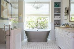 Don't you just love this stand alone bath tub? It is the perfect focal point to this cozy master bathroom!