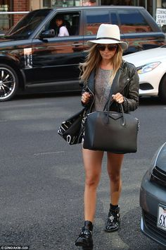 Edgy cool: Ashley wore her long blonde locks down in loose natural waves, looking the epit...