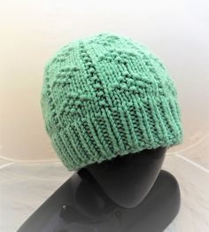 This is a quick to knit hat made with chunky weight yarn with a relaxed fit and easy texture. The diamond shapes are created with simple knit and purl stitches. Free pattern