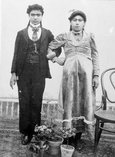 Two women, standing as a couple