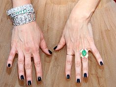 Kristen Wiig's deep-hued nails were set off by Neil Lane bracelets with diamonds, emeralds and platinum.