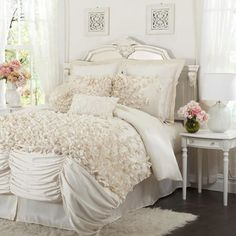 Bedrooms and linens ~ I would prefer if the ruffles continued up the comforter instead of the knots. The knots are gorgeous on the pillows though!