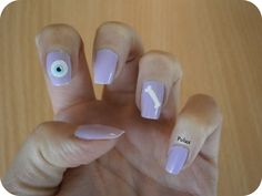 Pastel nails with eye and bone.  http://lesonglesenchantesdepolux.blogspot.fr/2013/05/pastel-nails.html