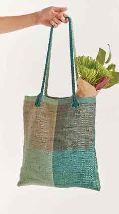 "What's an environmentally conscious girl to do with the plastic bags that inevitably find their way into our lives? Weave with them, of course! Plastic bag yarn, more commonly known as ""plarn"" is made by cutting plastic bags into loops that are joined together to create a long chain. The Take Two Tote, designed by Emily Werner for Easy Weaving with Little Looms 2018 is an easy introduction to weaving with plarn and a great way to use up any plastic bags you have sitting around."