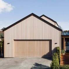 This home uses Abodo's Vulcan timber with Sioo:x finish extensively to the exterior of the property. Abodo's Vulcan Cladding is fast becoming the ideal choice for garage doors, with a weight of less than for thick material. Timber Garage Door, Garage Exterior, Carport Garage, Garage House, Garage Doors, House Cladding, Timber Cladding, Exterior Cladding, Modern Shed