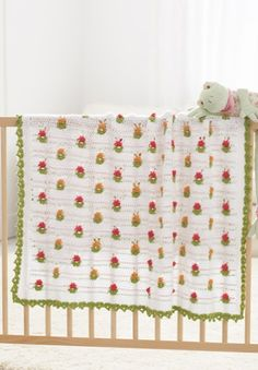 Bitty blossoms baby blanket, found on : http://www.naturallycaron.com/projects/bittyblossoms/bittyblossoms_1.html