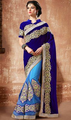 You will be ready to be in spotlight as you glide in this blue shade net velvet half and half saree. That you can see some interesting patterns carried out with moti, resham and stones work. #GorgeousTrendsetterSaree