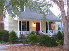 I have a light yellow house: maybe paint my green shutters black w/ a red door or all red!
