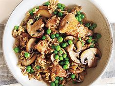 Chicken and Rice with Mushrooms | A small amount of dried porcini mushrooms goes a long way. Using the reconstituted mushrooms and their soaking liquid gives this one-dish meal a rich, earthy flavor.