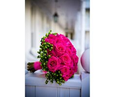 Bright pink roses pop with a frame of green hypericum. Shop roses and hypericum year-round in a variety of eye-catching colors at GrowersBox.com!