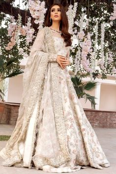 This ivory lehenga is in Dupion Silk fabric with dabka, sequins, kasab, beads zardozi embroidery. The blouse is in Silk fabric embellished with pearls, sequins. Dupatta is in Organza Silk with a four-sided embroidered border and gotta. For customisation please contact our sales team through WhatsApp +61470219564