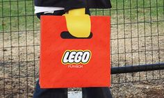 Two students from the School of Visual Arts of New York created a LEGO-branded promotional shopping bag that makes customers look a bit like LEGO minifigures.