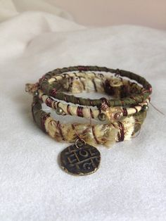 Set of gypsy hippie boho chic silk wrapped bangle bracelets with old coins.