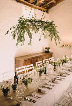 Brides: Greenery Chandelier of Olive Branches. Wispy olive branches help create an elegant-yet-unfussy atmosphere.