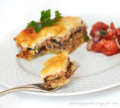 Moussaka - one of the most popular greek dishes made with eggplants, potatoes, ground beef and a rich white sauce on top. MMMM.MMMM..YUMMY!