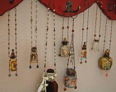 tiny altered prayer bottles. Don't need prayer bottles but like the way the bottles are altered.