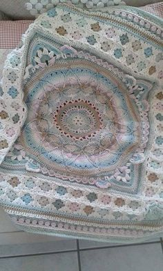 Sophie's garden turned into afghan with small granny squares and a tulip border, beautiful by Michelle van Aardt