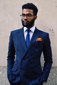 Solid Navy Double-breasted Suit (Black Lapel), Blue Glen Check Shirt (Black Lapel), Solid Royal Blue Tie (Black Lapel), Glasses (Warby Parker), Orange Pocket Square