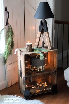 Make this super cool and easy faux industrial cart coffee crate side table with clamps and other rusty junk hardware. Here it's topped with an industrial pipe and sawhorse lamp. | funkyjunkinteriors.net #christmas #crates #rustic #furniture #funkyjunk