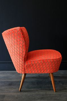 The Bartholomew cocktail chairs were produced in Germany in the 1950s with tapered legs typical of the period and a plain curved back that hugs you