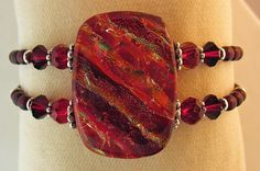 Sea Of Glass Studios Fire Bracelet made from fused dichroic glass with assorted glass and sterling silver beads. American Made. See the artist's work at the 2014 Buyers Market of American Craft, Philadelphia, PA. January 18-21, 2014. americanmadeshow.com #bracelet, #dichoricglass, #fusedglass, #glass, #glassjewelry, #jewelry, #americanmade