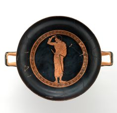 Terracotta kylix (drinking cup). Attributed to the Antiphon Painter. Archaic. ca. 490 B.C. Greek, Attic. Interior, youth wearing phorbeia (lip band) and holding double flute (aulos); inscribed the boy is fair. Music was an integral part of education, with the flute and the lyre as the primary instruments. The youth on the interior must just have stopped playing because he still wears the phorbeia.