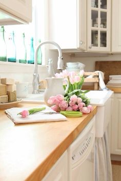 Beautiful kitchen with pink tulips.
