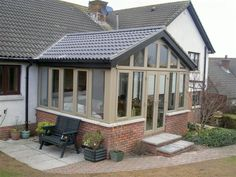 If you're looking to make an addition to your house or fully upgrade your existing conservatory, Refrb.uk Ltd have the vision and expertise to help Bungalow House Plans, Bungalow House Design, Living Room Extension Ideas, Sunroom Dining, Dining Tables, Porch Extension, Rear Extension, Small Conservatory, Green Roof Benefits