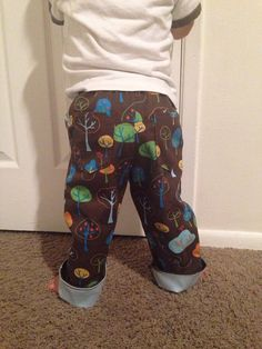 This is the only pants pattern you'll need for your cloth diapered kiddo! It features a generous booty to keep even the largest cloth diapers contained, four snaps on either side of the waist. When unsnapped, the pants open up wide to make them easy to slip over large cloth diapers. The waist is all one piece so there isn't any hassle with tucking parts in. Join our facebook group to chat about projects, patterns and for help on your project, https://www.facebook.com/groups/suatchat