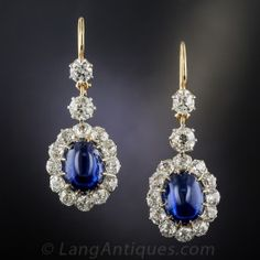 11.48 Carat Natural Cabochon Sapphire and Diamond Antique Drop Earrings - A pair of rich, cobalt blue, no-heat sugarloaf cabochon sapphires, weighing 11.48 carats total are elegantly presented in these extraordinary drop earrings dating from the turn-of-the-twentieth-century. The royal blue gemstones are framed by 7.00 carats of sparkling old-mine cut diamonds and are surmounted by pairs of larger diamonds.  Wonderful and wearable Edwardian-era jewels. #vintage #sapphire #langantiques