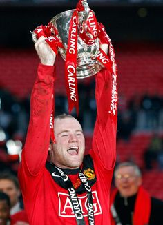 Wayne Rooney lifts the trophy after beating Aston Villa in the English League Cup final in 2010.