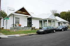 ghost-houses-facade-bracketed-duplex-and-two-new-houses