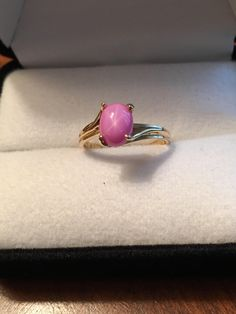 A personal favorite from my Etsy shop https://www.etsy.com/listing/520869157/14k-gold-solitaire-linde-lindy-pink-star