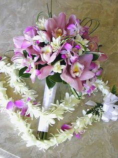 Lavender Cymbidium Orchids, Dendrobium Orchids and Tuberose accents with Bear Grass Loops