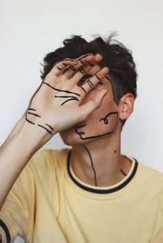 The highlighted outline of his face contorting as his expression grimmed. Black lines jutting awkwardly from his pale skin