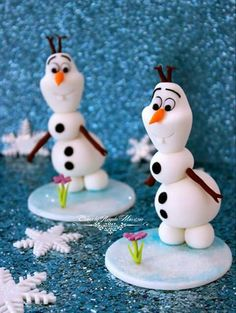 Olaf cupcake toppers by Cakes by Angela Morrison