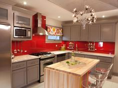 I love these grey cabinets with red accents