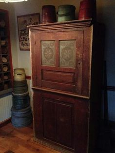 Punched tin cupboard in a somewhat natural wood look. It may have been stained but it sure is beautiful!
