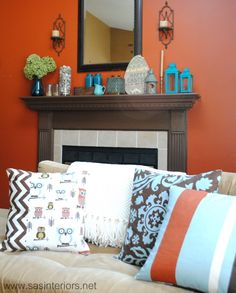Mantle decor/colors. Orange, turquoise brown and cream.
