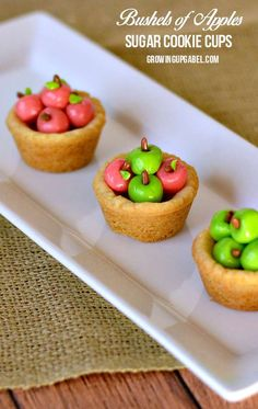 Give your cookie jar a fall makeover with these easy to make sugar cookie cup apple baskets! A simple sugar cookie is made in to baskets and filled with apples made from one of your favorite candies! Easy to make, this cookie recipe lasts for days as a cute fall centerpiece - or lasts for minutes as a fun snack.