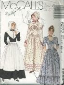 An original ca. 1991 McCall's pattern 5272.  Misses' Costumes:  Long dresses A, B, C with stand-up collar and D with scoop neckline have fitted bodice with shaped waistline seam, gathered skirt, back zipper closing.  Long sleeves A, C have darted cap.  Long sleeves B and above elbow length sleeves D have gathered cap.  View A has detachable collar, apron and hat.  B has hemline ruffle and ribbon and lace trim.  C has ribbon trim, ruffled shawl and hat.  D has hemline ruffle and...