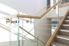 Stair | Staircase | Commercial | Non Slip Treads | Tasmanian Oak | Closed Stair | Carpet | Timber Handrail | Glass Balustrade | Stainless Steel Brackets