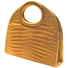 Rare, Oversized Architectural Handbag in Blonde Crocodile   From a collection of rare vintage top handle bags at https://www.1stdibs.com/fashion/handbags-purses-bags/top-handle-bags/