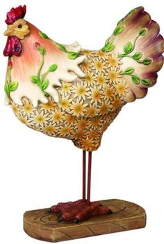 Nice home decor rooster with embedded hand painted flowers. This is a hand crafted polystone product simulated to look like wood. Features - 4.00in x 7.75in x 12.50in - Cold Cast Polystone - Hand Pain