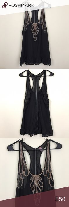 """Free People Black Embroidered Racerback Top Beautiful embroidered racer-back top by Free People  • Size 10 • Full length shoulder to hem 32"""" • In excellent condition; no stains, holes, or flaws • Full Zipper on back side of shirt Free People Tops"""