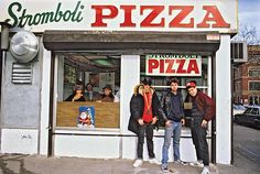 The Beastie Boys pose in front of the iconic Stromboli Pizza joint in this photo taken by Lynn Goldsmith. Own a limited-edition Beastie Boys print today!